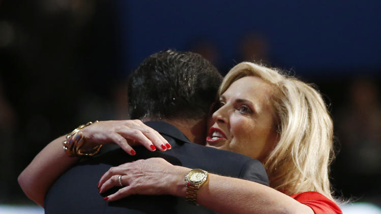 Republican presidential nominee Mitt Romney hugs his wife Ann Romney on stage at the Republican National Convention in Tampa, Fla. on Tuesday, Aug. 28, 2012. (AP Photo/Jae C. Hong)