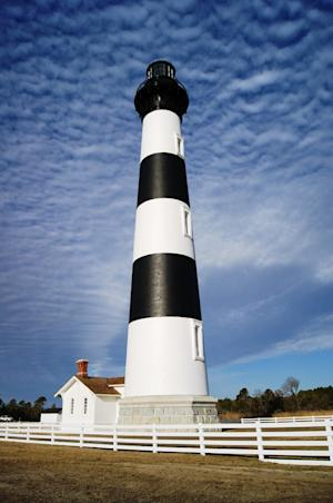 This Thursday Jan. 10, 2013 image provided by the National Park Service shows the renovated Bodie Island Lighthouse on North Carolina's Outer Banks. The Bodie Island Lighthouse underwent a three-year, $5 million restoration. The tower was built in 1872 as is listed on the National Register of Historic Places. It opens Friday, April 19, 2013, to the public. (AP Photo/National Park Service, Cyndy Holda)