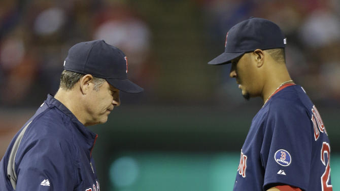 Boston Red Sox manager John Farrell, left, pulls starting pitcher Felix Doubront in the fourth inning of a baseball game against the Texas Rangers on Friday, May 3, 2013, in Arlington, Texas. (AP Photo/LM Otero)