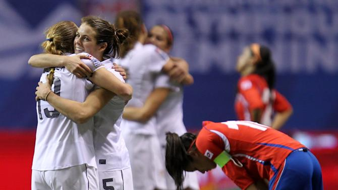 United States' Rachel Buehler (19) and Kelly O'Hara (5) celebrate their team's 3-0 win over Costa Rica in CONCACAF women's Olympic qualifying soccer game action at B.C. Place in Vancouver, British Columbia, Friday, Jan. 27, 2012. (AP Photo/The Canadian Press, Jonathan Hayward)