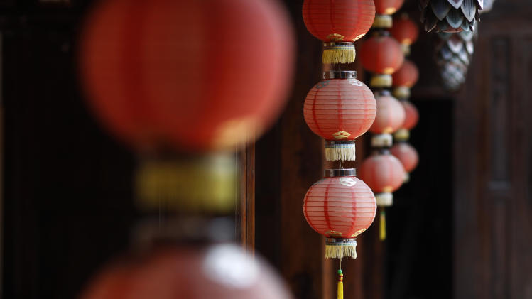 In this June 14, 2011 photo, lanterns decorate the restored wooden panels of the famed 150-year-old Lin Family Mansion in Wufeng, Taiwan. The Lin Family Mansion, a complex of five buildings on 7.4 acres, is one of Taiwan's most important historical sites, a rare example of the ornate architectural style favored by nobles from southern China in the waning years of the Qing dynasty.    (AP Photo/Wally Santana)