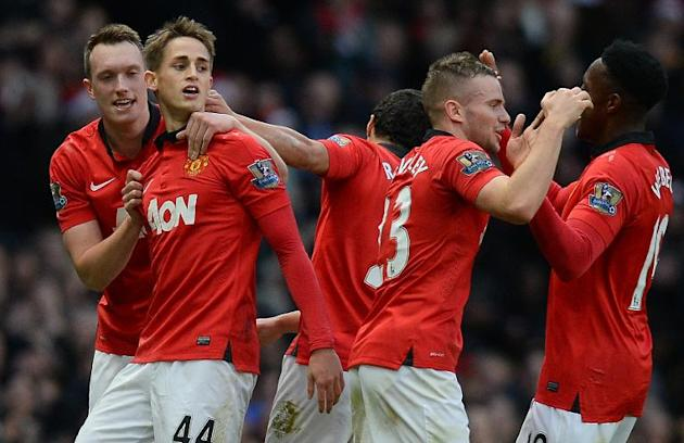 Manchester United's midfielder Adnan Januzaj (2ndL) celebreates with team-mates Phil Jones (L), Tom Cleverley (2ndR) and Danny Welbeck (R) after scoring his team's second goal at Old Trafford,