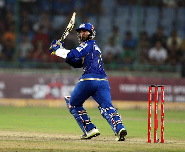 MI batsman Dinesh Karthik in action during the 2nd CLT20 semi-final match between Mumbai Indians and Trinidad & Tobago at Feroz Shah Kotla, Delhi on Oct. 5, 2013. (Photo: IANS)