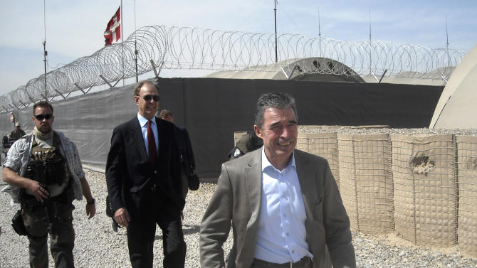 NATO Secretary-General Anders Fogh Rasmussen, front, tours with Maurits Jochems, center, NATO ambassador to Afghanistan, the ISAF headquarters Task Force Helmand, Tuesday, March 5, 2013. NATO's chief is embracing a proposal to keep 352,000 Afghans in uniform through 2018 — about 122,000 more than originally planned. (AP Photo/Kimberly Dozier)