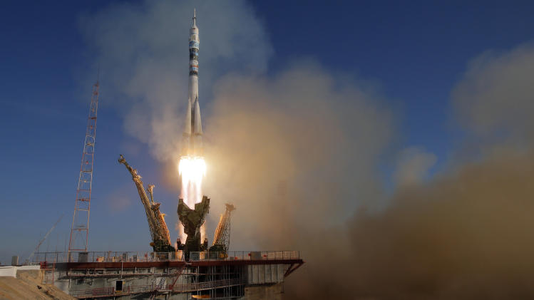 The Soyuz-FG rocket booster with Soyuz TMA-11M space ship carrying new crew to the International Space Station, ISS, blasts off at the Russian leased Baikonur cosmodrome, Kazakhstan, Thursday, Nov. 7, 2013. The rocket carrying the Olympic flame successfully blasted off Thursday from earth ahead of the Sochi 2014 Winter Games. (AP Photo/Dmitry Lovetsky)
