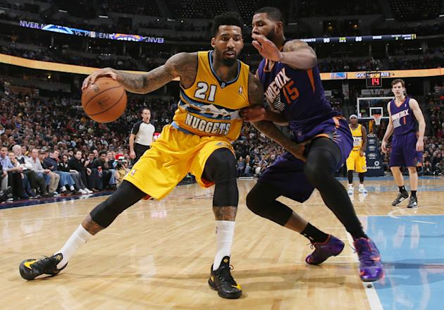 Denver Nuggets forward Wilson Chandler, left, works ball inside as Phoenix Suns forward Marcus Morris covers in the third quarter of the Suns' 103-99 victory in an NBA basketball game in Denver on