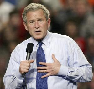 FILE - In this May 7, 2004 file photo, George W. Bush speaks to supporters at a campaign rally, in Prairie Du Chien, Wi. Going back to 1956, no incumbent president has lost when unemployment fell over the two years leading up to the election.  (AP Photo/Darren Hauck, File)