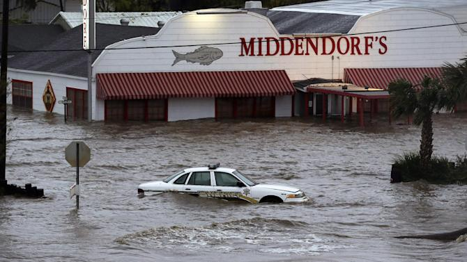 A sherriff's vehicle sits in flood waters caused by Isaac, Thursday, Aug. 30, 2012, north of LaPlace, La, off Lake Pontchartrain. Isaac's maximum sustained winds had decreased to 45 mph and the National Hurricane Center said it was expected to become a tropical depression by Thursday night. The storm's center was on track to cross Arkansas on Friday and southern Missouri on Friday night, spreading rain as it goes.  (AP Photo/Eric Gay)
