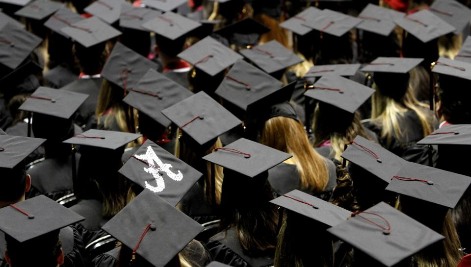 Students participate in the graduation ceremonies at the University of Alabama on Saturday, Aug. 6, 2011, in Tuscaloosa, Ala.  (AP Photo/Butch Dill)