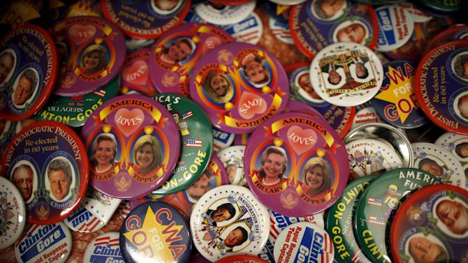 Pins showing Hillary Clinton and Tipper Gore are seen amongst others at the Clinton Museum Store in Little Rock, Arkansas