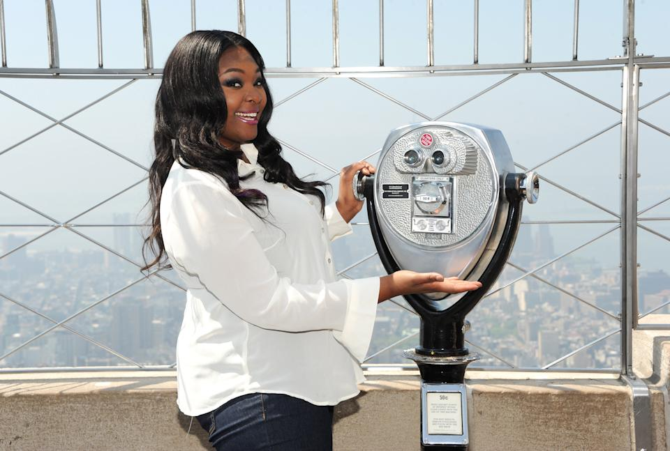 "Candice Glover,""American Idol"" season 12 winner, visits the Empire State Building's 86th floor Observatory on Tuesday, May 21, 2013 in New York. (Photo by Evan Agostini/Invision/AP)"