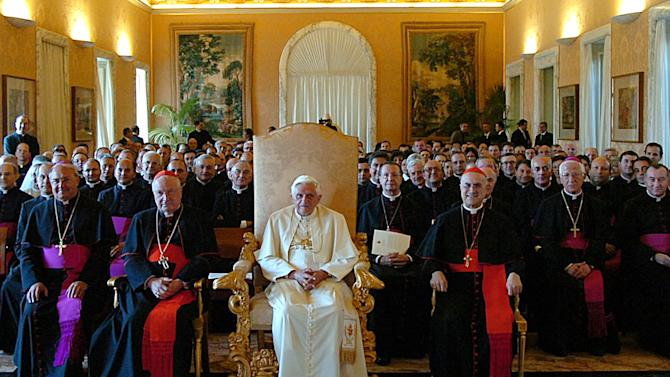 "FILE - This Sept. 15, 2006 file photo released by the Vatican's newspaper L'Osservatore Romano shows Pope Benedict XVI, at center, presiding a meeting with outgoing Vatican Secretary of State Cardinal Angelo Sodano, left foreground in red, and the new Vatican's No. 2 official Cardinal Tarcisio Bertone, right foreground in red, during a meeting at the Vatican. After 35 years under two ""scholar'' popes who paid scant attention to the internal governance of the Catholic Church, a chorus is growing that the next pontiff must have a solid track record managing a complicated bureaucracy.  Benedict was well aware of the problems, having spent nearly a quarter-century in the Vatican's Congregation for the Doctrine of the Faith. But he never entered into the Vatican's political fray as a cardinal _ and as pope left it to his No. 2, Cardinal Tarcisio Bertone, to do the job. (AP Photo/L'Osservatore Romano, ho, files)"