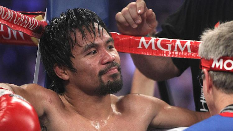 Manny Pacquiao, of the Philippines, sits in his corner between rounds of his WBO welterweight title boxing fight against Timothy Bradley Saturday, April 12, 2014, in Las Vegas. (AP Photo/Isaac Brekken)