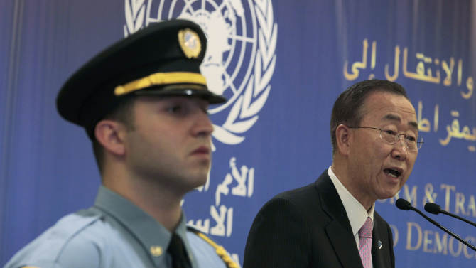"""U.N. Secretary-General Ban Ki-moon, right, speaks during the opening session of a conference on democracy in the Arab world, in Beirut, Lebanon, Sunday Jan. 15, 2012. Ban demanded Sunday that Syria's president stop killing his own people, and said the """"old order"""" of one-man rule and family dynasties is over in the Middle East. (AP Photo/Hussein Malla)"""