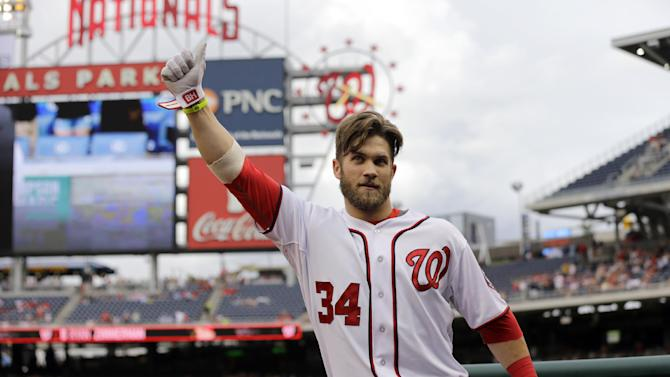 Washington Nationals Bryce Harper acknowledges the fans after his solo home run during the first inning of a baseball game against the Milwaukee Brewers at Nationals Park Monday, July 1, 2013, in Washington. This is Harper's first game back after being on the disabled list. (AP Photo/Alex Brandon)