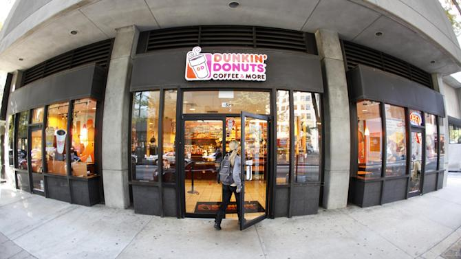 A customer enters a Dunkin' Donuts store Monday, Oct. 31, 2011, in Atlanta. Dunkin' Brands Group Inc., the parent of Dunkin' Donuts and the Baskin-Robbins ice cream chain, said Tuesday, Nov. 1, 2011, that its net income plummeted 61 percent in the July-to-September quarter, as the company paid charges related to going public and paying down debt. (AP Photo/John Bazemore)