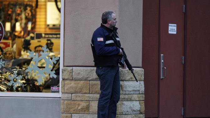 A law enforcement official secures the scene after a shooting at Clackamas Town Center in Portland, Ore., Tuesday, Dec. 11, 2012. A gunman is dead after opening fire at the shopping mall Tuesday, killing two people and wounding another, sheriff's deputies said. (AP Photo/The Oregonian, Thomas Boyd)