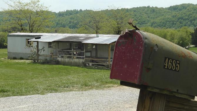 """A home in Cumberland County, Ky, is seen on May 1, 2013, where a 2-year-old girl was shot by her 5-year-old brother with a gun designed for children. Investigators say the Tuesday shooting was accidental. The children's mother was home at the time of the shooting Tuesday afternoon but had stepped out to the front porch for a few minutes and """"she heard the gun go off,"""" Cumberland County Coroner Gary White said. He said the rifle was kept in a corner and the family didn't realize a bullet was left inside it.(AP Photo/Dylan Lovan)"""