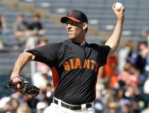 Bumgarner, Scutaro solid as Giants tie ChiSox 9-9