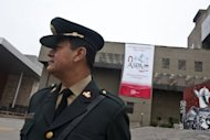 A police officer stands guard outside the Ministry of Culture in Lima, on September 28. Peruvian police are on high alert as part of tight security deployment for the Third Summit of South American and Arab Countries (ASPA) to be held next week