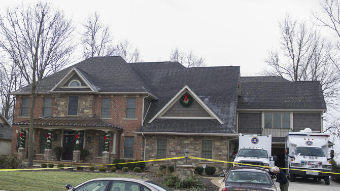 """The FBI and local law enforcement search the home of Michael Fabini, brother of National Football League player Jason Fabini, Thursday,  Dec. 6, 2012 at Cherry Hill Parkway in Fort Wayne, Ind.  Federal, state and local officers with the Safe Streets Task Force raided a Fort Wayne property owned by Jason Fabini, a home owned by his brother, Michael Fabini, and five other area properties Thursday.  FBI Special Agent David Crawford declined Friday, Dec. 7, 2012,  to say why the properties were raided, saying only that there was """"investigative activity"""" going on there. The task force focuses on combatting illegal drugs and violent crime.  (AP Photo/The Journal Gazette, Swikar Patel) MANDATORY CREDIT"""