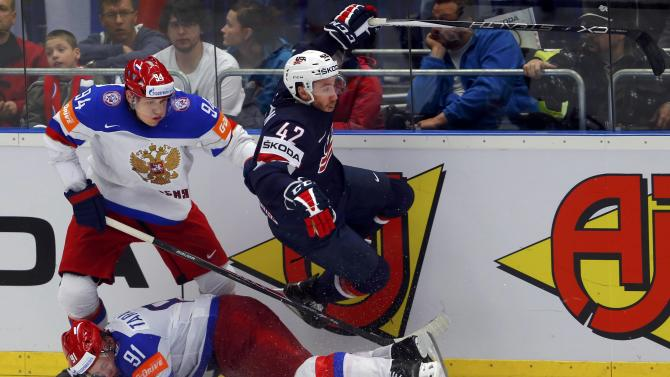 Sexton of the US collides with Russia's Tarasenko and Mironov during their ice hockey World Championship game against Russia during their ice hockey World Championship game in Ostrava