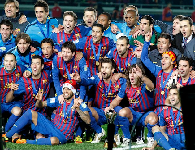 Spain's FC Barcelona players celebrate after winning over Brazil's Santos FC in  the final at the Club World Cup soccer tournament in Yokohama, near Tokyo, Japan, Sunday, Dec. 18, 2011. (AP Photo/Koji