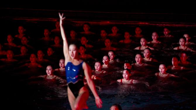 In this Feb. 15, 2013 photo, North Korean women perform during a mass synchronized swimming event to mark what would have been the birthday of the late leader Kim Jong Il in Pyongyang, North Korea. (AP Photo/David Guttenfelder)
