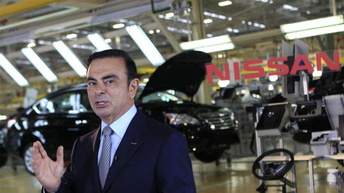 Nissan CEO Ghosn speaks during an interview with Reuters at the company's new plant in Aguascalientes
