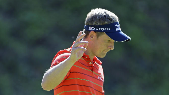 Luke Donald, of England, waves after saving par on the sixth green in the second round of the Northern Trust Open golf tournament at Riviera Country Club in the Pacific Palisades area of Los Angeles Friday, Feb. 15, 2013. (AP Photo/Reed Saxon)