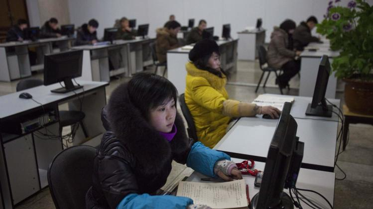 North Koreans work at computer terminals inside the Grand People's Study House in Pyongyang, North Korea on Wednesday, Jan. 9, 2013. (AP Photo/David Guttenfelder)
