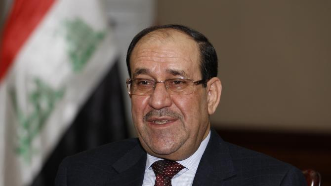 File photo of Iraq's Prime Minister al-Maliki speaking during an interview with Reuters in Baghdad
