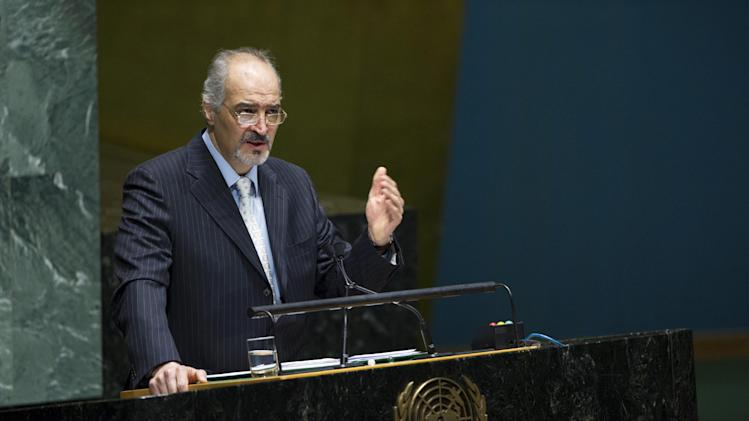 In this photo provided by the United Nations, Syria's U.N. Ambassador Bashar Ja'afari addresses the United Nations General Assembly, Wednesday May 15, 2013. The U.N. General Assembly approved an Arab-backed resolution calling for a political transition in Syria and strongly condemning President Bashar Assad's regime for its escalating use of heavy weapons.The resolution, which is not legally binding, was adopted by a vote of 107-12 with 59 abstentions. (AP Photo/United Nations, Evan Schneider)