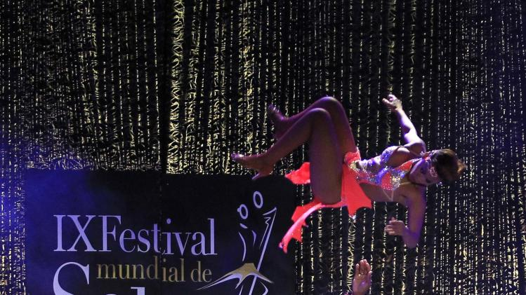 Colombian dancers Rivas and Solano participate in an exhibition dance during the 9th World Salsa Festival in Cali