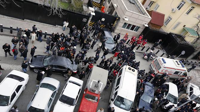 Elevated view of the side entrance of the U.S. Embassy in the Turkish capital, Ankara, after a suspected suicide bomber detonated an explosive device, Friday Feb. 1, 2013. The bomb appeared to have exploded inside the security checkpoint at the entrance of the visa section of the embassy. A police official said at least two people are dead.(AP Photo)
