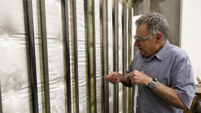 FILE-In this Wednesday, May, 9, 2012, file photo, businessman Earl Kluft, who manufactures luxury mattresses, performs the final step in fully securing all materials to provide mattresses maximum support and longevity, at his factory in Rancho Cucamonga, Calif. The Commerce Department reported Tuesday, July 3, 2012, that factory orders increased 0.7 percent in May. U.S. factories received more orders in May from April after two consecutive months of declines, as businesses demanded more goods that signal investment plans. (AP Photo/Damian Dovarganes, File)