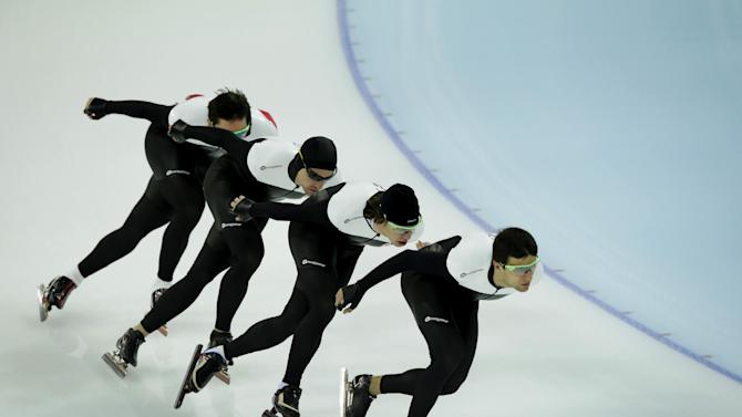 Denny Morrison, second from left, practices with other Canadian speedskaters during a training session for the 2014 Winter Olympics, Thursday, Feb. 20, 2014, in Sochi, Russia