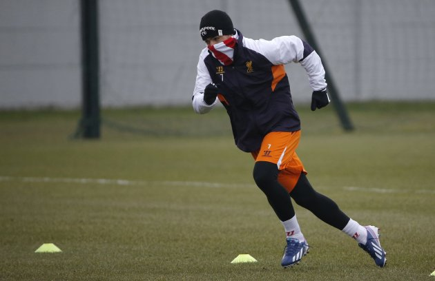 Liverpool's Suarez runs during a training session at the club's Melwood training complex in Liverpool