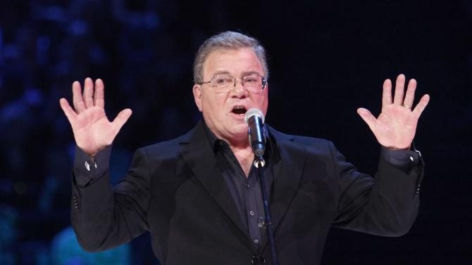 """FILE - In this April 1, 2012 file photo, William Shatner hosts the Juno Awards in Ottawa, Ontario. A publicist for the actor tells The Virginian-Pilot the former commander of the fictional starship Enterprise on TV's """"Star Trek"""" is abandoning plans to attend the Saturday, Dec. 1 retirement ceremony for the USS Enterprise at Norfolk Naval Station. He announced earlier he would be attending. (AP Photo/The Canadian Press, Fred Chartrand, File)"""