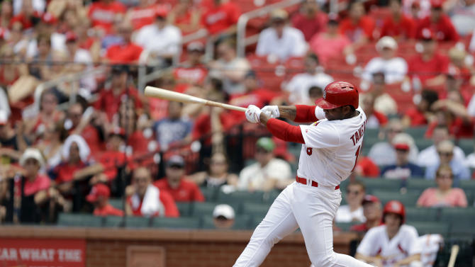 St. Louis Cardinals' Oscar Taveras swings during the sixth inning of a baseball game against the San Francisco Giants Sunday, June 1, 2014, in St. Louis. (AP Photo/Jeff Roberson)