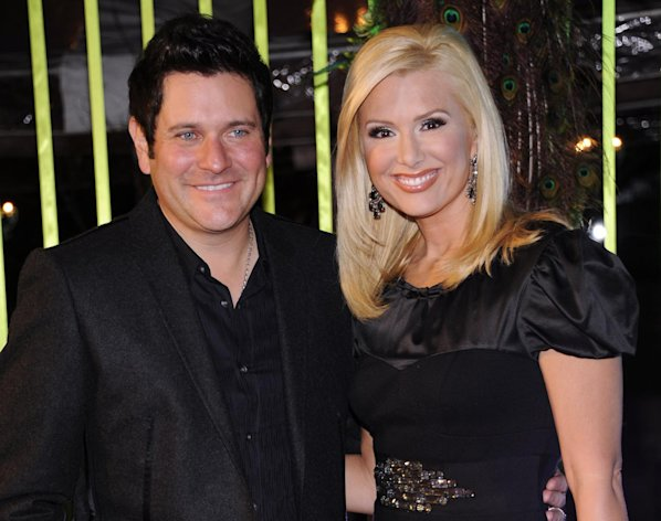 FILE - This Nov. 8, 2011 file photo shows Jay DeMarcus of Rascal Flatts, left, and his wife, Allison at the 59th Annual BMI Country Awards in Nashville, Tenn. DeMarcus and his wife Allison, a former Miss Tennessee and a current CMT personality, welcomed their second child, a son named Dylan Jay DeMarcus on Friday, July 20, 2012. (AP Photo/Evan Agostini, file)