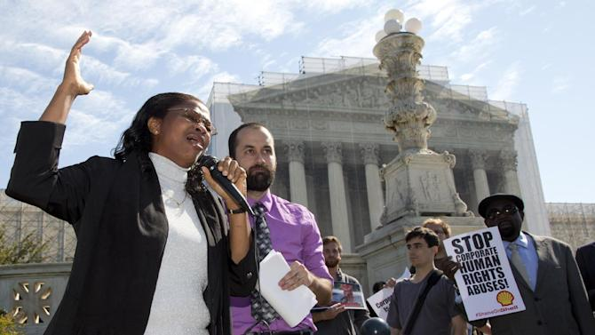 Nigerian widow Esther Kiobel, a plaintiff in Kiobel v. Royal Dutch Petroleum, cries as she speaks outside the Supreme Court in Washington, Monday, Oct. 1, 2012. Standing with her second from left is Brad Weikel with EarthRights International.  (AP Photo/Carolyn Kaster)