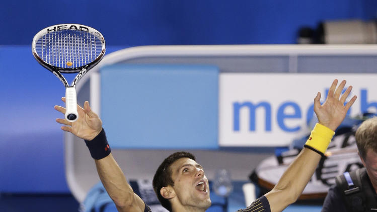 Serbia's Novak Djokovic tosses his racquet as he celebrates his win over Britain's Andy Murray in the men's final at the Australian Open tennis championship in Melbourne, Australia, Sunday, Jan. 27, 2013. (AP Photo/Andy Wong)