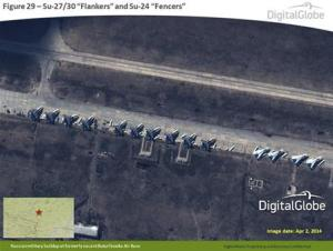 A satellite image provided to Reuters by SHAPE and taken by DigitalGlobe shows what is reported by SHAPE to be Russian Su-27/30 Flankers and Su-24 Fencers at a military base in Buturlinovka