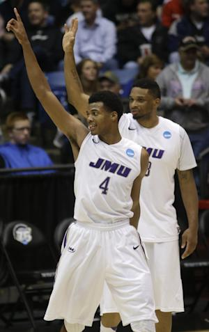 James Madison guard Charles Cooke (4) and forward Rayshawn Goins celebrate after they defeated LIU Brooklyn 68-55 in a first-round game of the NCAA college basketball tournament on Wednesday, March 20, 2013, in Dayton, Ohio. (AP Photo/Al Behrman)