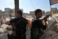 Syrian rebels man a checkpoint in the northern city of Aleppo. A commercial hub and home to 2.5 million people, Syria&#39;s second city Aleppo has become a new front in the country&#39;s 16-month uprising, after being largely excluded from the violence