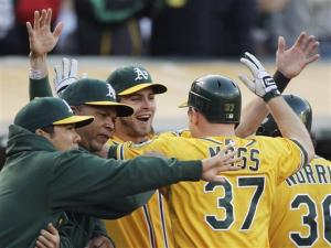 Reddick, Moss homer to lead A's past Red Sox 6-1