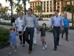 Republican presidential candidate, former Massachusetts Gov. Mitt Romney, second from right, walks with his family to dinner at BurgerFi on Sunday, Oct. 21, 2012 in Delray Beach, Fla.  From left, grandson Miles, wife Ann, son Craig, daughter-in-law Mary, grandson Parker, and Romney. (AP Photo/ Evan Vucci)