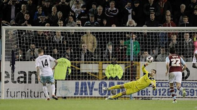 Matt Taylor, left, scores from the spot to put West Ham in front