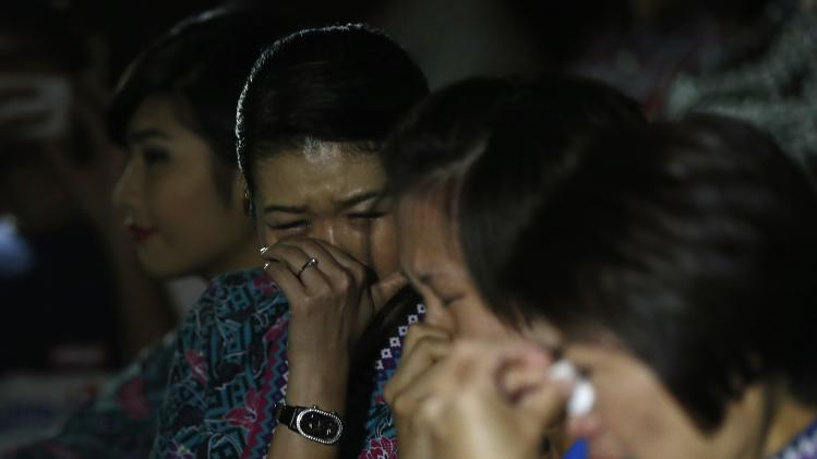 Malaysia Airlines flight attendants cry during a multi-faith event to pray for passengers and crew of MH17 at the airline's academy in Kuala Lumpur